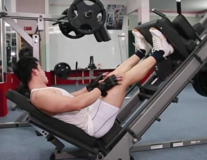 a man is doing 45 Degree Leg Press