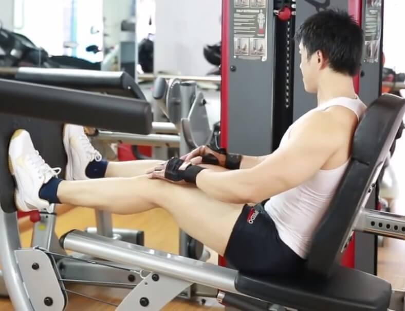 a man is doing Horizontal Leg Press