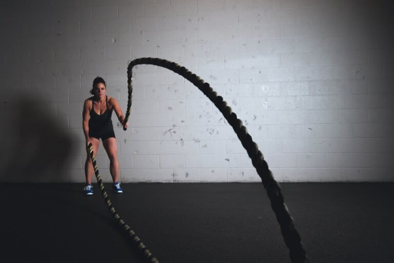 a woman is exercising to lose weight