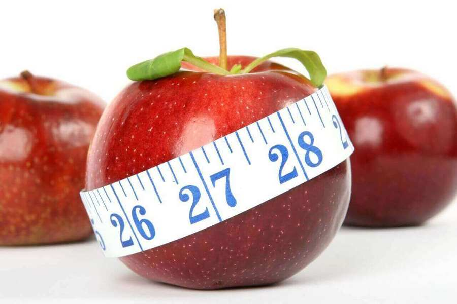 apple and tape measure to maintain weight loss