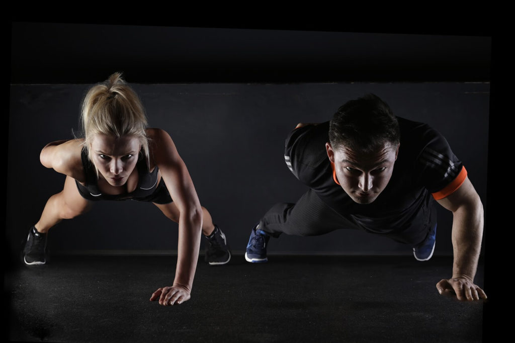 a man and woman are exercising to tighten muscles