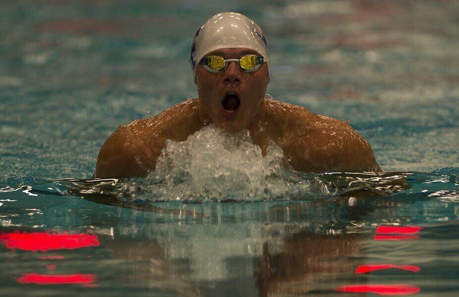 man is swimming